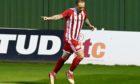 Formartine United striker Jonny Smith celebrates scoring his second goal.