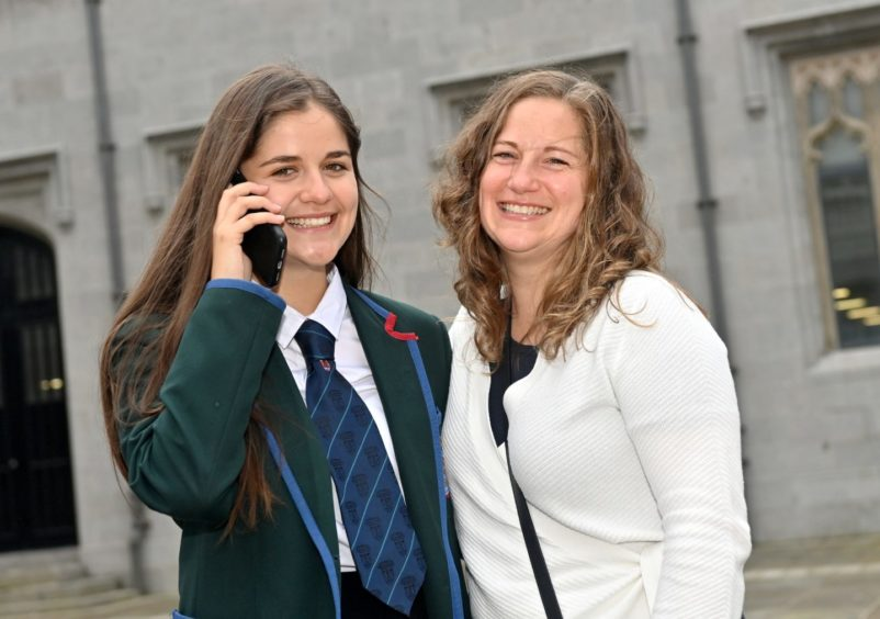 Lily Macdonald celebrates with her mum Emma Davidson after recieving a call to tell her she been accepted into university.