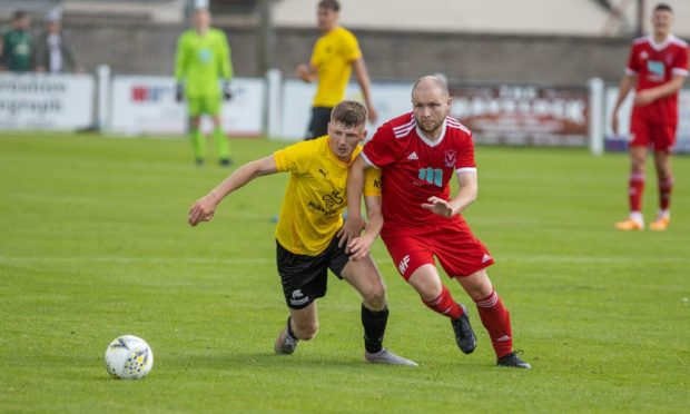 Dane Ballard, right, in action for Deveronvale against Nairn