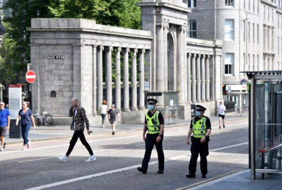 Police arrested the man in an Aberdeen city centre churchyard