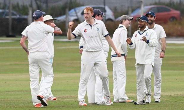 Stoneywood-Dyce captain Jamie King celebrates taking the wicket of Arbroath's Matthew Parker. Picture by Paul Glendell