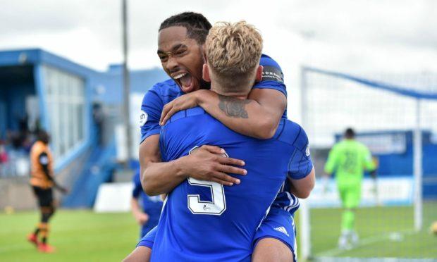 Niah Payne celebrates his goal with striker partner Russell McLean.