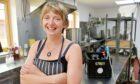 Hannah Taylor of Gut Feelings Kombucha, Findhorn, with some of her produce in her production kitchen.