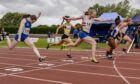 Roisin Harrison wins the 100m at the Scottish track and field championships.