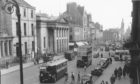 Aberdeen's Union Street as it was in 1958. The building on the left of the Music Hall was the old home of the YMCA which was demolished in the 1960s.