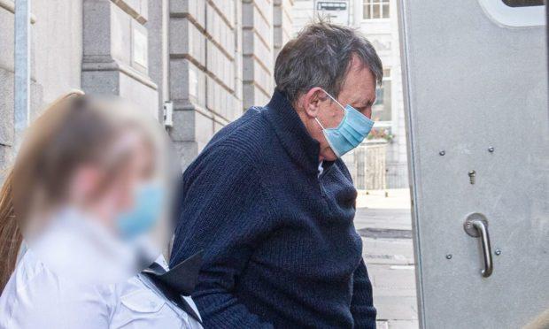 John Strathdee leaving court.