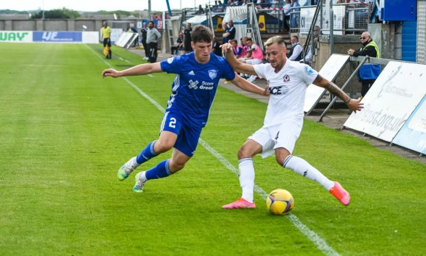 Connor Scully (right) in action for Cove Rangers.