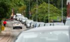 Traffic was building up on Muggiemoss Road on Monday