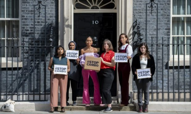 Campaigners hand in an open letter signed by over 80,000 people to Downing Street opposing the huge new Cambo oil field off Shetland. Stop Cambo / David Mirzoeff