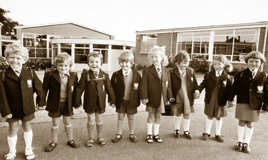 It was first day smiles from this line up of new pupils arriving at Aberdeen's Walker Dam Infant School in 1978 for the start of the new term.