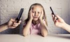 Our children pay attention to how we use our tech devices (Photo: Marcos Mesa Sam Wordley/Shutterstock)