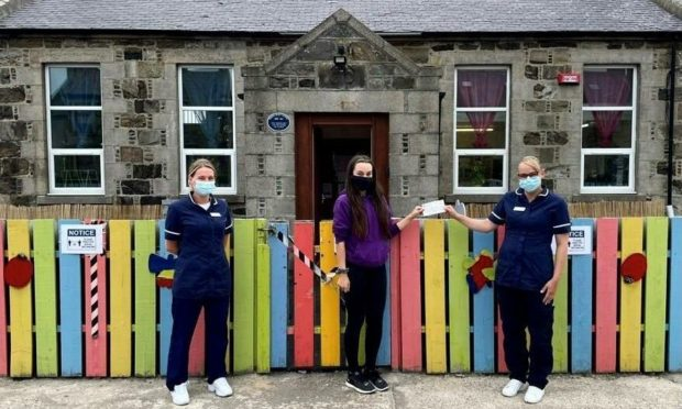 A Fraserburgh care home helped facilitate the installation of a life-saving defibrillator machine outside a local nursery. Picture shows Debbie Simpson, deputy care home manager of Meallmore's St Modans, Morgan Duncan, staff member at Playbarn Nursery and Julie-Anne Thomson, care home manager of St Modans.
