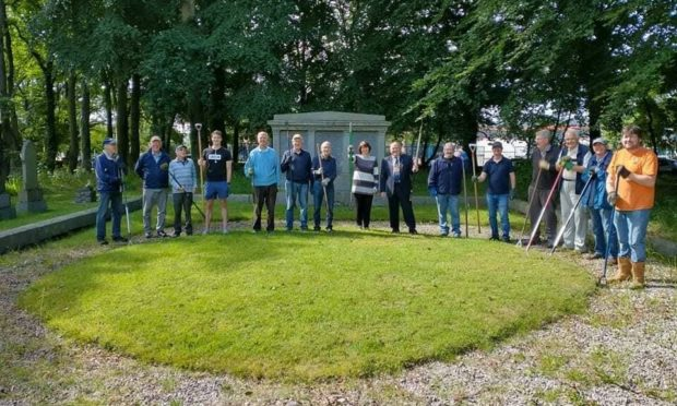 Volunteers helped tidy up Dyce West graveyard after gates were locked since October last year.