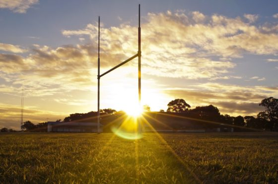 Goal posts for football, rugby union or league on field at sunset; Shutterstock ID 107464289; Purchase Order: -