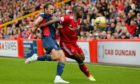 Aberdeen's Austin Samuels (23) and Ross County's  Connor Randall (2) in the 1-1 draw.