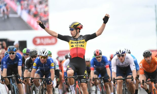 Wout van Aert crosses the line first to win the Tour of Britain.