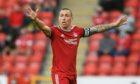 Aberdeen team captain Scott Brown leads the way.