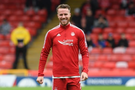 ABERDEEN, SCOTLAND - AUGUST 29: New Aberdeen signing Marley Watkins warms up pre-match during a cinch Premiership match between Aberdeen and Ross County at Pittodrie, on August 29, 2021, in Aberdeen, Scotland (Photo by Ross Parker / SNS Group)