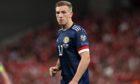 Lewis Ferguson in action for Scotland against Denmark.