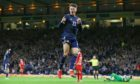 Scotland's Nathan Patterson celebrates after his shot is tapped in by Lyndon Dykes as Scotland go 1-0 up against Moldova.