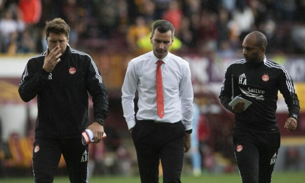 Aberdeen manager Stephen Glass (centre), No.2 Allan Russell and coach Henry Apaloo after the loss at Motherwell.