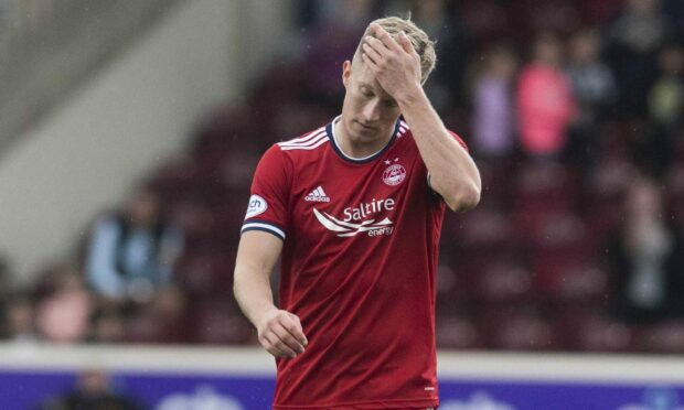 Defender Ross McCrorie insists 'daft mistakes' are costing Aberdeen.
