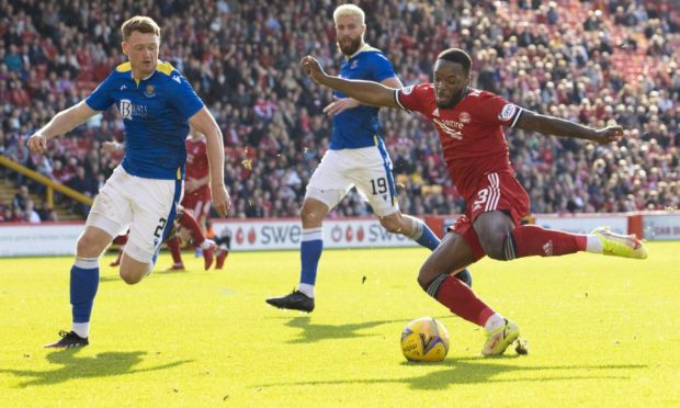 Aberdeen attacker Austin Samuels is closed down by St Johnstone's James Brown (left) at Pittodrie.