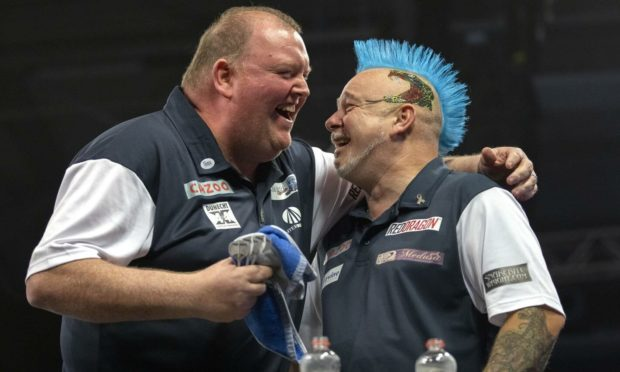 To go with story by Danny Law. John Henderson and Peter Wright teamed up in the World Cup of Darts.  Picture shows; John Henderson and Peter Wright teamed up in the World Cup of Darts. . Jena, Germany. Supplied by Kais Bodensieck/PDC Europe Date; 12/09/2021