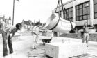 1985 - The Trumpet Leaf sculpture being lowered on to the new pedestrian deck of the St Nicholas Centre