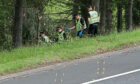 File photo dated 09/07/15 of police officers searching the scene at Junction 9 of the M9 near Stirling where John Yuill and Lamara Bell were discovered. Representatives from Police Scotland will appear at Edinburgh High Court on Tuesday to give evidence in the M9 death crash case. Issue date: Tuesday September 7, 2021. PA Photo. John, 28, and his partner Lamara, 25, died after lying in a crashed car for three days after the incident was first reported to police.
