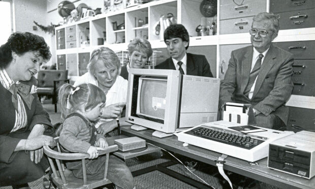 1990 - Melanie, 2, takes a keen interest in the screen of a computer bought for the Raeden Centre with a £1000 donation from the Halifax Building Society