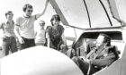 1982 - Donald Mackenzie holds the canopy for wife Susan, who was taking her second training trip in a glider and is pictured with, from left, solo pilots Mark Bissett and Willie Stephen, and the Deeside Gliding Club's instructor Alan Middleton