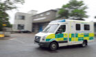 An Ambulance goes past the offices of the Scottish Ambulance Service, Ashgrove Road West, Aberdeen.