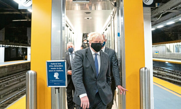 Prime Minister Boris Johnson prepares to board a train from Penn Station in New York to Washington DC where he will meet US President Biden later today.  Picture date: Tuesday September 21, 2021.