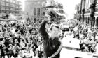 A fresh-faced Alex Ferguson holds aloft the Premier League championship trophy at the Castlegate in front of cheering fans. 12/05/1980