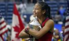 Emma Raducanu  hugs the US Open championship trophy