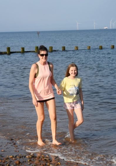 Pictured at Aberdeen beach are Debbie Corkey left and her daughter Sarah, 11. Picture by Chris Sumner.