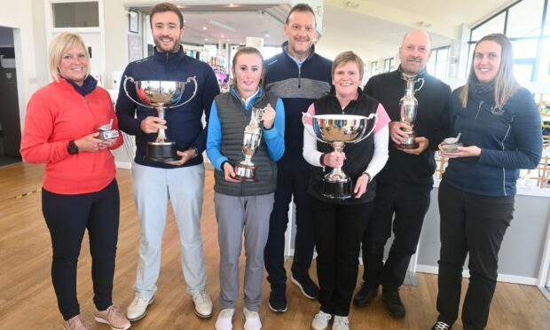 Evening Express Champion of Champions finals winners: Peter Mutch, centre from Aberdein Considine with the winners and runner's up from left, Marie McCallum, Adam Dunton, Emma Logie, Julie Henderson, Michael Laird and Kelly Guthrie.