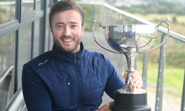 Adam Dunton with the Evening Express Champion of Champions men's scratch trophy. Picture by Chris Sumner