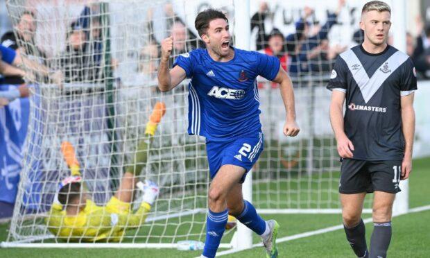 Morgyn Neill celebrates his last-minute winner for Cove Rangers.