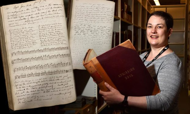NHS Grampian archivist Fiona Musk with pages from Captain Dick's case notes.