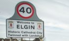 """Road signs entering Elgin describe it as a """"historic cathedral city. Photo: DCT Media"""