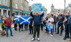 John Henderson cheered by locals as he returned home in Huntly as World Cup champion.