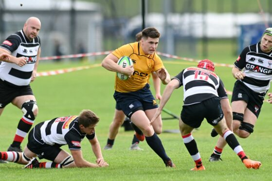 Sean Mills running with the ball for Gordonians.
