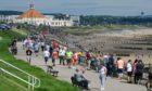 People enjoy warm weather on Aberdeen beach in June. Photo: Kenny Elrick/DCT Media