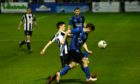 Fraserburgh's Sean Butcher, left, and Huntly's Cameron Booth battle for the ball