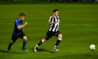 Fraserburgh's Ryan Cowie, right, looks to get away from Huntly's Alexander Jack