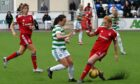 Aberdeen's Eilidh Shore (right) challenges Olivia Chance of Celtic