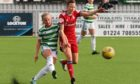 Celtic's Maria Olafsdottir Gros and Chloe Gover of Aberdeen compete for the ball