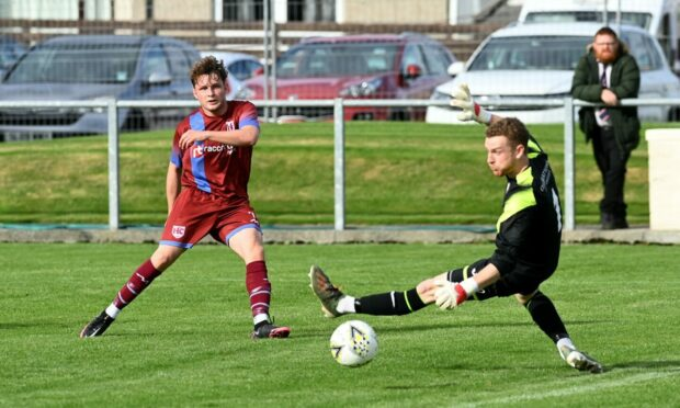 Michael Ironside, left, scores Keith's first goal against Turriff